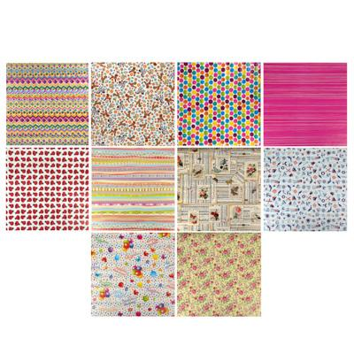 Бумага упаковочная, 70х100 см, мелованная, 65-70 г, 16 дизайнов